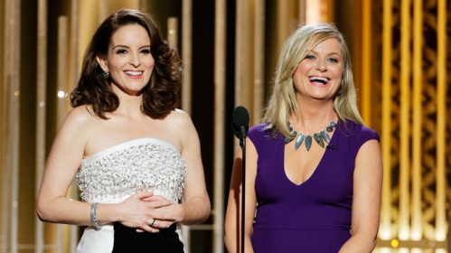 Fey and Poehler, having a laugh about Bill Cosby.